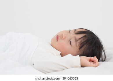 asian kid having nap time