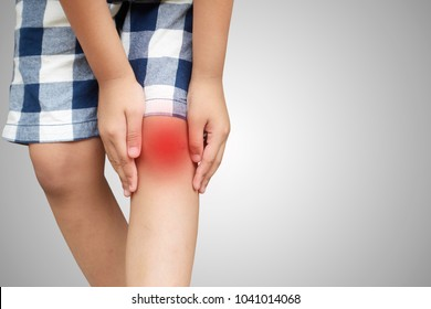 Asian kid with knee pain, isolated background