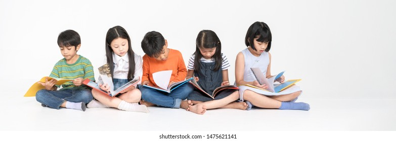 Asian Kid Read Book Together, Education Concept