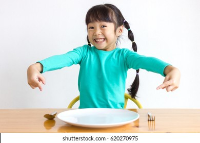 Asian kid with spoons and forks.
