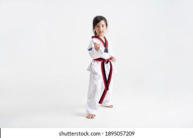 Asian kid Taekwondo in white studio