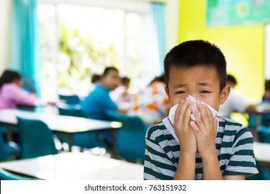 Asian kid with the tissue, he got a cold. Most infections come from the school.