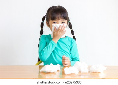 Asian kid with the tissue, she got a cold.