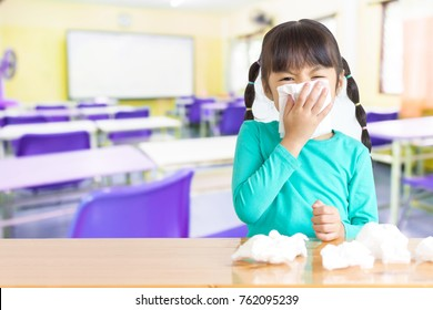 Asian kid with the tissue, she got a cold. Most infectious children are caught by friends at school.