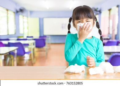 Asian kid with the tissue, she got a cold. Most infections come from the school.