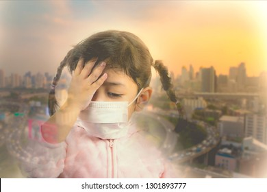 Asian kid wearing mask to protect herself from the bad Air pollution in the city
