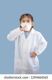 asian kids with air polution protect mask with white doctor suite costume. Portrait action as block smoke smell on blue background (include clipping path)