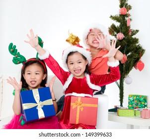 Asian kids celebrating christmas