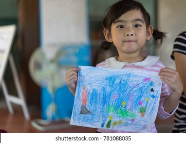 Asian Kids cute little girl drawing
