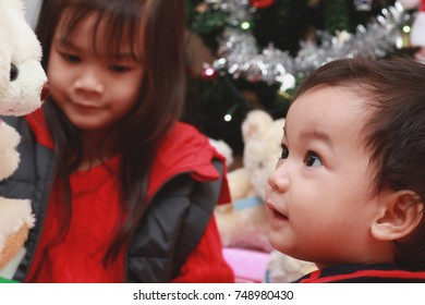 Asian kids decorate the Christmas tree.Happy family concept.Selective focus.