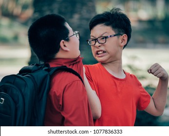 Asian kids fighting in school violence with the kids concept