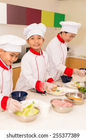 Asian kids having cooking lesson