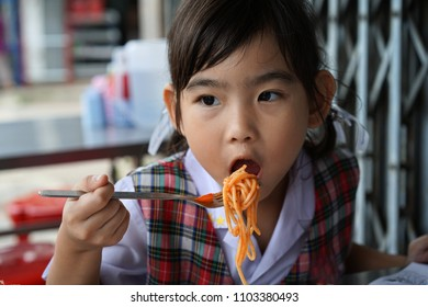 Asian kids little girl Eating Spaghetti