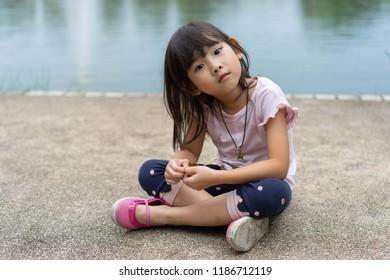Asian kids little girl Sitting in Garden
