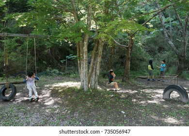 asian kids play in the forest