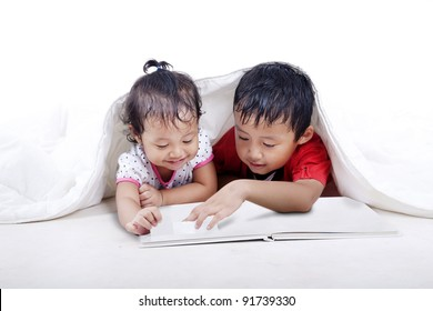 Asian kids reading an empty book isolated on white