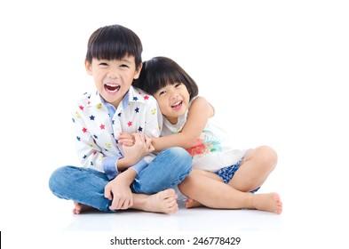 Asian kids sitting on the floor