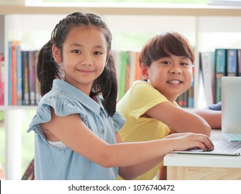 Asian kids using laptop computer in classroom school and education concept