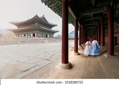 Asian Korean woman dressed Hanbok in traditional dress walking in Gyeongbokgung Palace in Seoul, South Korea.