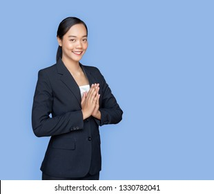 asian lady with business uniform suite in greeting action call Sawasdee in Thai traditional greeting as Hello on isolated background (Include clipping path)