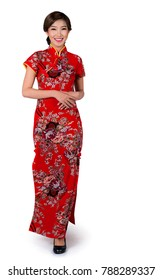 Asian lady in Chinese new year dress or cheongsam in standing and walking position on isolated white backgroung, this immage included for clipping part for easy to use