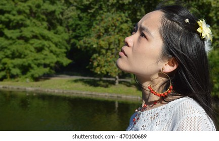 Asian lady in park