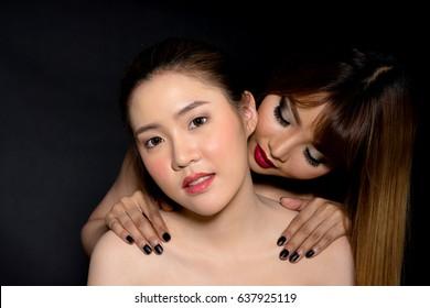 Asian lesbian twins