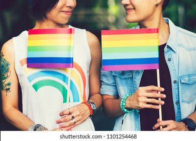 Asian lesbian holding  LGBT  rainbow flag