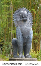 Asian lion guard sculpture on a pedestal.