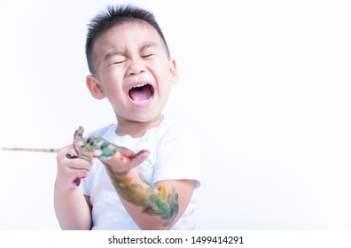 Asian little baby childhood very happy he playing use paintbrush draw watercolor or fingerpaint on hand by oneself, Baby 2-3 years