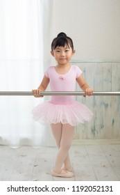 asian little ballerina on lesson