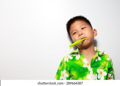 Asian little boy is brush his teeth