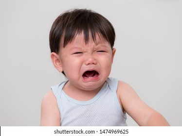 Asian little boy cry and feel sad