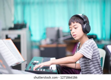 Asian little boy play piano  study music classroom