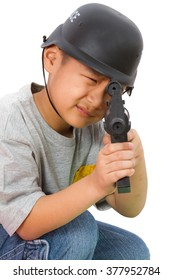 Asian Little Boy Playing Plastic Toy AK47 with Police Helmet on White Background