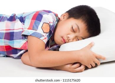 Asian little boy sleeping in bed.