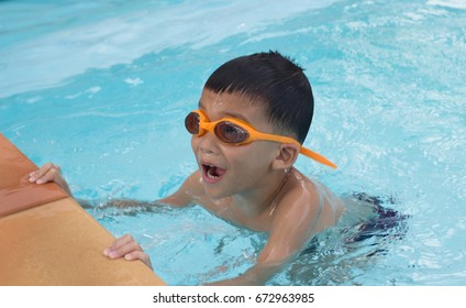 Asian little boy in the swimming pool