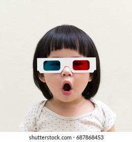 Asian little child wearing 3d glasses over white background