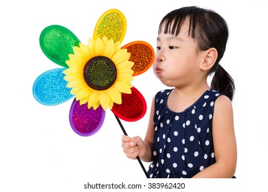 Asian Little Chinese Girl Blowing Colorful Windmill isolated on White Background