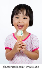 Asian Little Chinese Girl Eating Ice Cream isolated on White Background