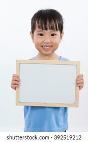 Asian Little Chinese Girl Holding a Whiteboard isolated on White Background