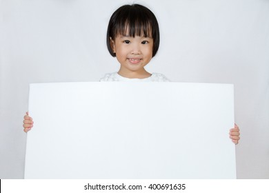 Asian Little Chinese Girl Holding a White Blank in isolated White Background