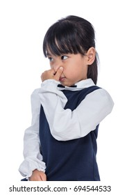 Asian Little Chinese Girl holding her nose because of a bad smell in isolated White Background