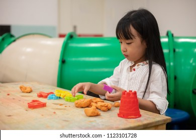 Asian Little Chinese Girl Playing Colorful Clay in Indoor Playground