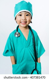 Asian Little Chinese Girl Playing a Doctor with Stethoscope in isolated White Background