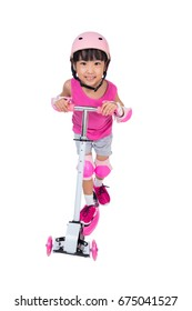 Asian little Chinese girl playing with scooter in isolated white background