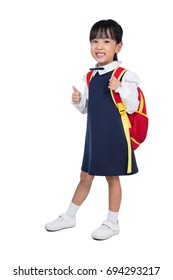 Asian Little Chinese girl in school uniform with school bag in isolated white background