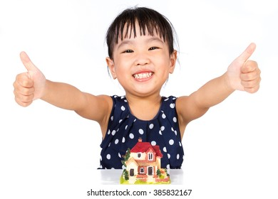 Asian Little Chinese Girl With Toy House for Property Concept isolated on White Background