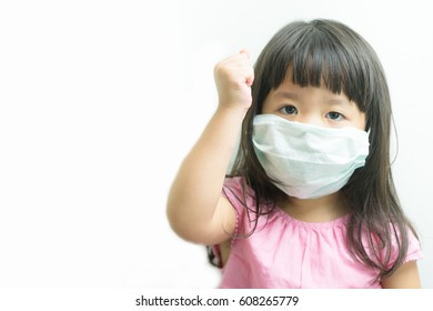 Asian Little Chinese Girl Wearing a Protective Mask and show fighting hand in Isolated White Background.