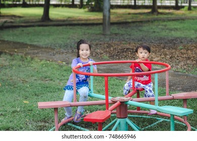 Asian little cute boy and girl in the playground
